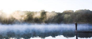 man on still lake